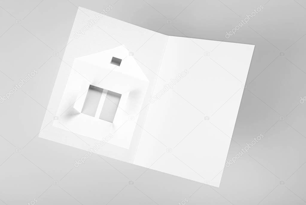 Blanc folded card with house. Copy space