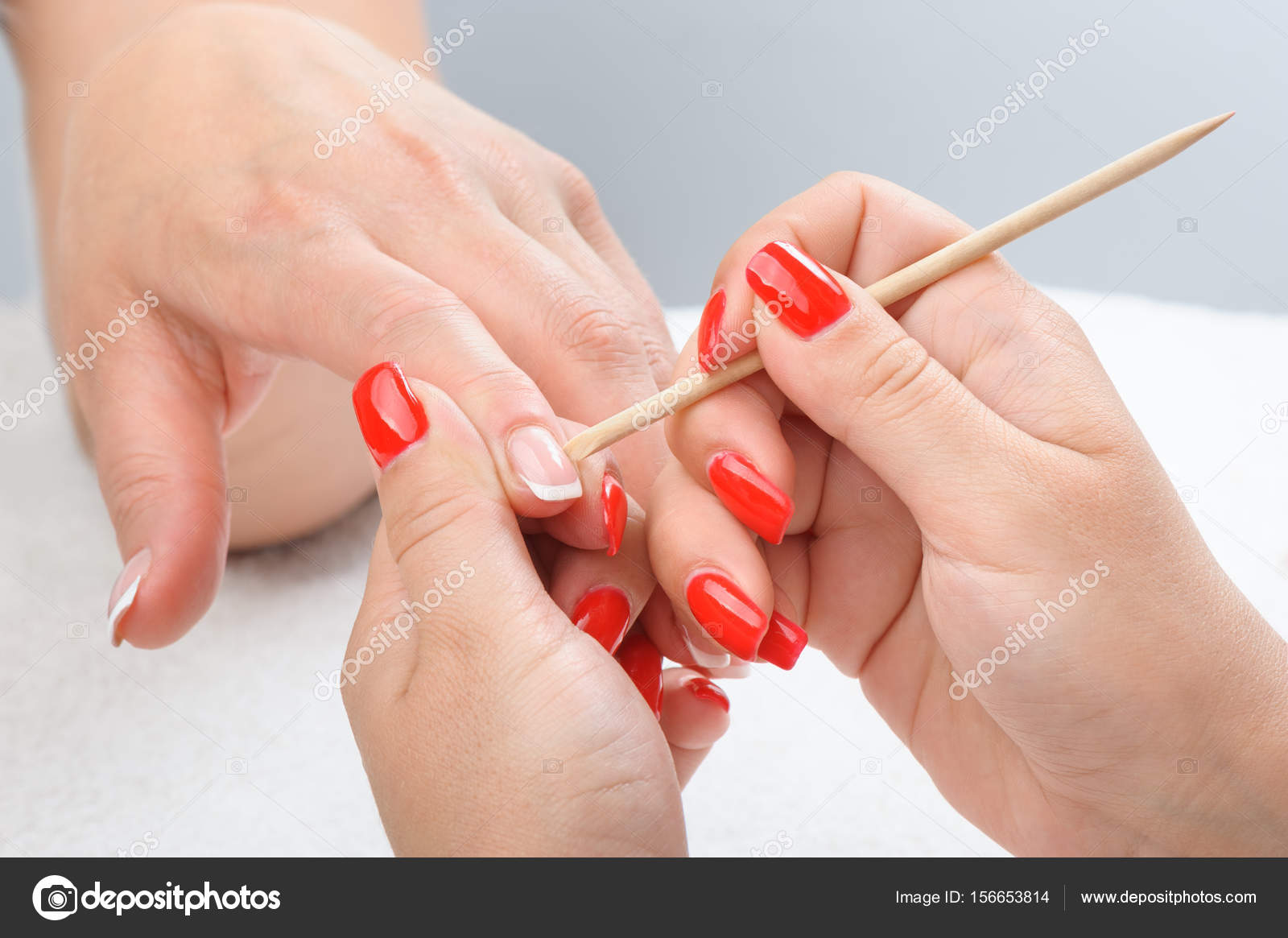 Cuticles care with cuticle pusher — Stock Photo © starush #156653814