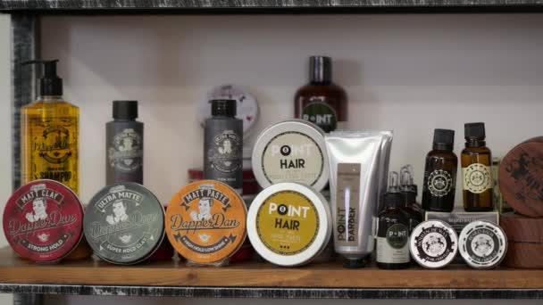 Detail of assorted barbershop supplies products at showcase shelves