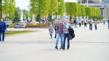 Locomotor deseased teenager walking with mother