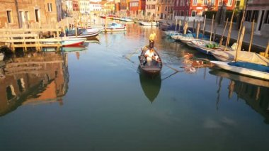 Gondola passing by in canal of Murano