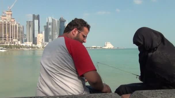 Veiled muslim women fishing at Corniche