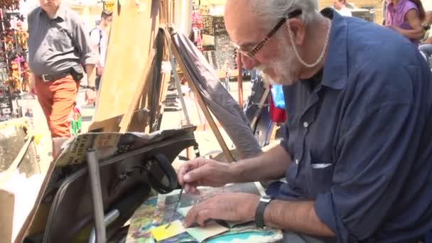 Malíř na ulici v Palazzo Pitti