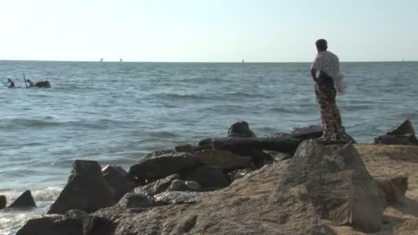 Man standing near the sea