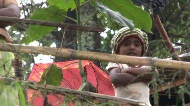 Little boy looking in camera