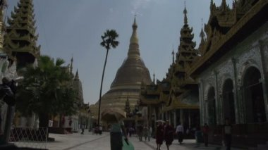 People passing by Shwedagon Pagoda