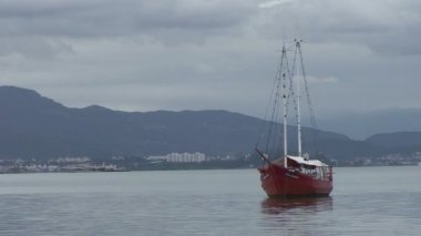 Footage of Florianopolis, red boat in sea