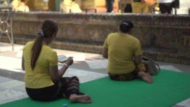 women praying at Shwedagon Pagoda,