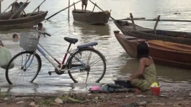 girl doing the laundry in the river