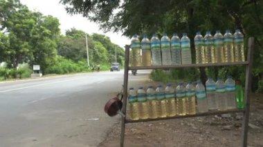 gasoline in bottles on street
