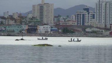 Footage of fishermen in Florianopolis, harbour