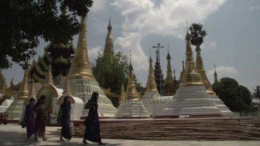 Women passing by Shwedagon Pagoda