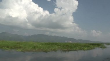 floating on lake and mountains on background