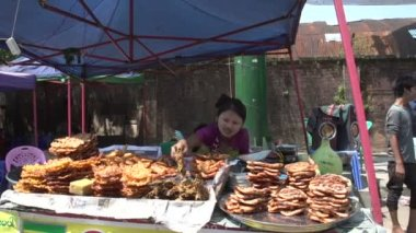 Yangon, woman with tanaka at stall