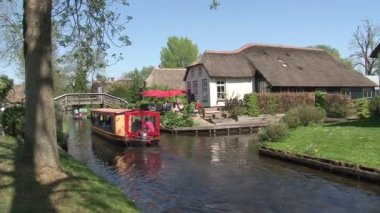 Footage of Boats with tourists on channel  in Giethoorn