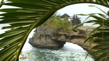 Pura Penataran Luhur temple behind palmtree, Bali, Indonesia