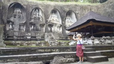Woman take photo  in front of Gunung Kawi Temple in Ubud, Bali