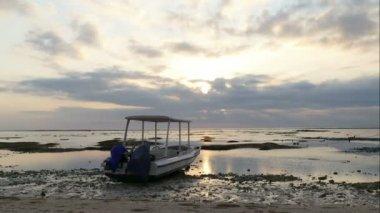 Sunset behind speedboat on Lembongan beach, Bali, time lapse
