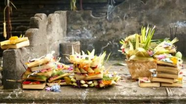 Offering bowls and incense at Tirta Empul Temple, Bali