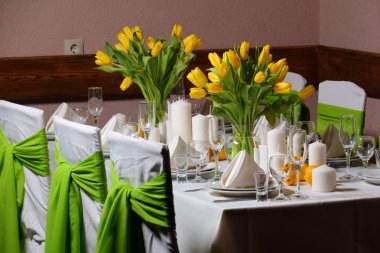 Decoration of the holiday table yellow tulips.