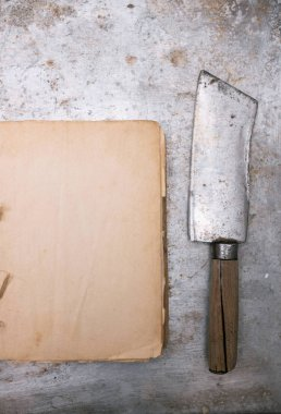 Vintage meat cleaver and blank cookbook