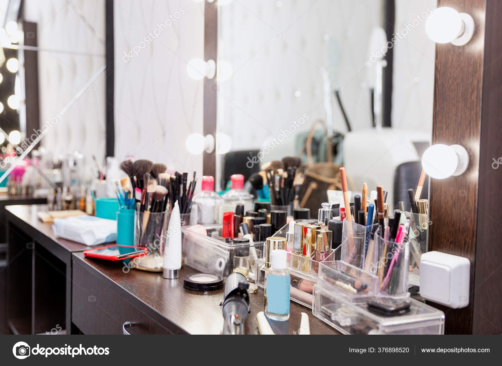 Dressing table in a beauty salon with lots of cosmetics. 6