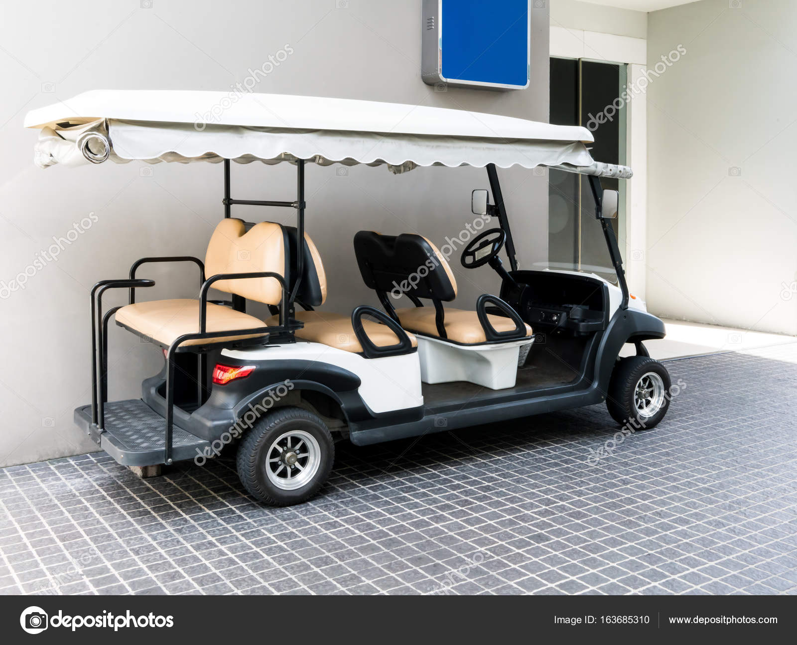 White golf cart with back seats in the public building — Stock Photo on golf cart accessories rear seats, golf cart front bucket seats, ez go golf cart seats, ezgo golf cart custom seats, ezgo golf cart replacement seats, cheap gas golf carts,