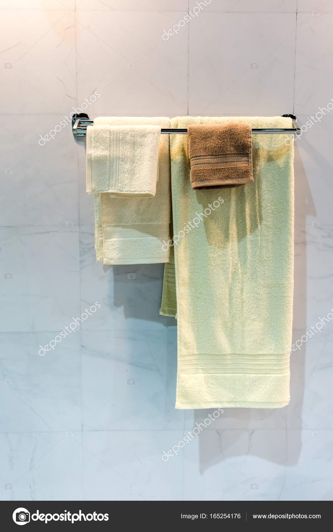 Folded hanging towel Bathroom Towels New Yellow And Brown Folded Towels Hanging On Metal Rail Under Stock Photo Depositphotos New Yellow And Brown Folded Towels Hanging On Metal Rail Under