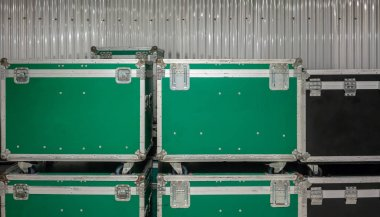 Set of green and black aluminium wooden flight cases.