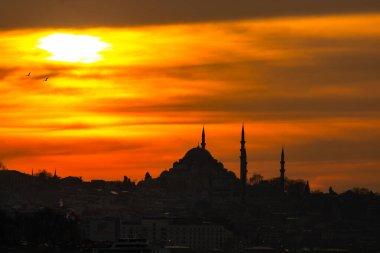 Suleymaniye Mosque at Sunset in Istanbul. Ramadan, iftar, kandil, kadir gecesi (laylat al-qadr), islamic new year, eid mubarak background photo.