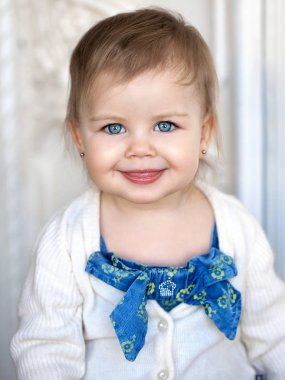 funny little girl shows tongue