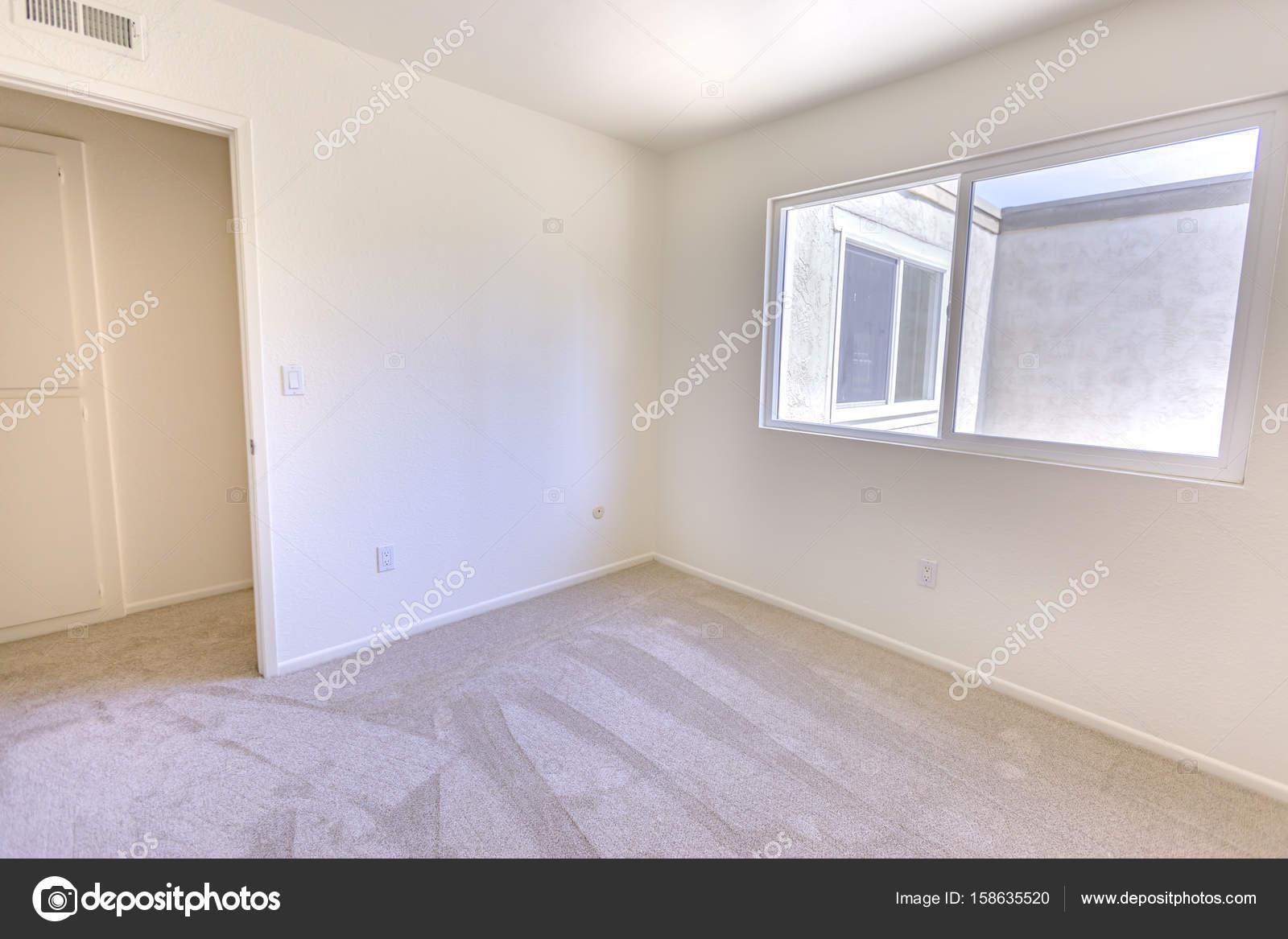 Empty Bedroom With Carpet And Window Stock Photo C Dropthepress