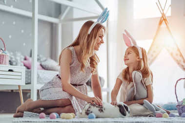 Mom and daughter preparing for Easter celebration