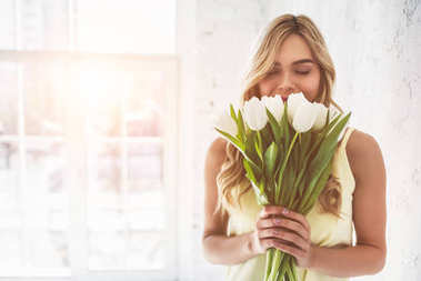 Young woman with tulips