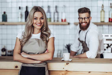 Couple of barista in coffee shop