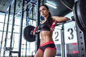 Fotografie sportovní žena v tělocvičně