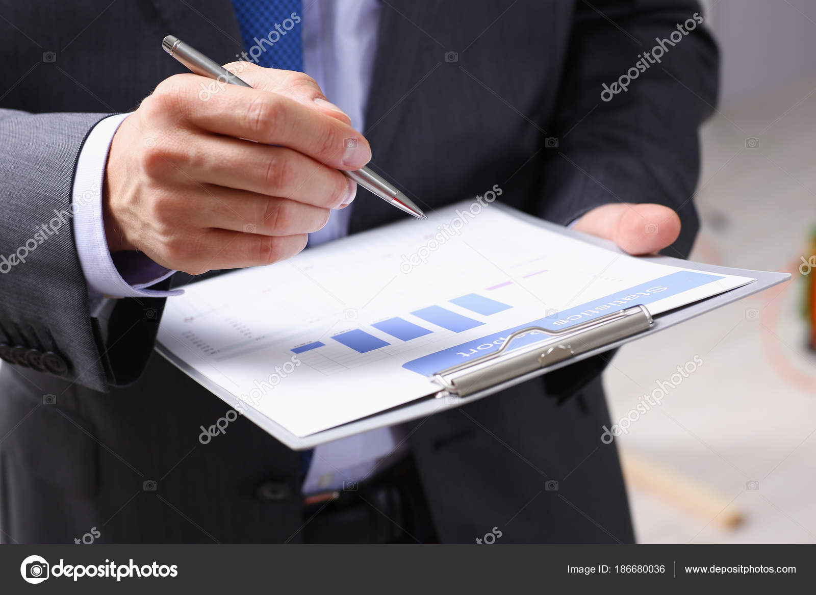 Hand of businessman in suit filling and signing — Stock