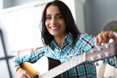 Happy lady with guitar