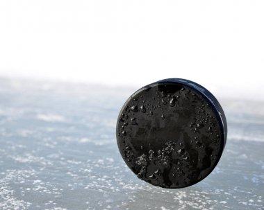 Black Hockey Puck.