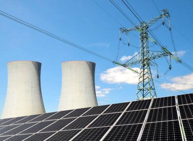 Solar panels, nuclear power plant and electricity pylon.