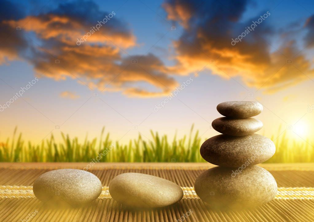 Stack of Zen pebble stones at sunset.