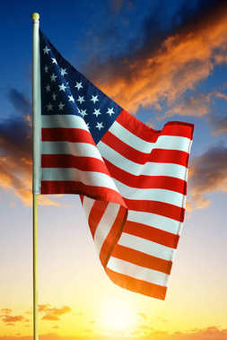 American waving flag in the sunset.