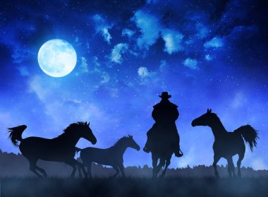 Silhouette cowboy wit horses at night sky with moon.