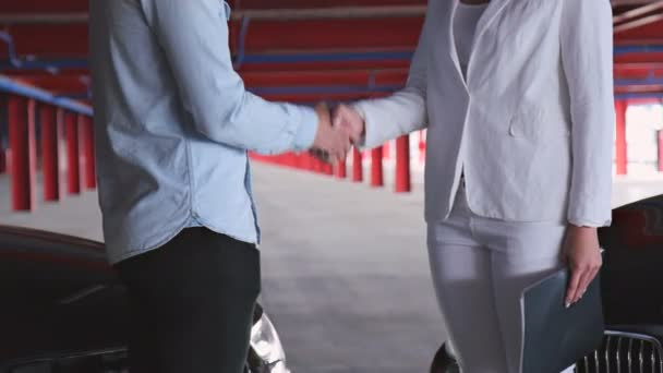 Businessman and Businesswoman Greet Each Other