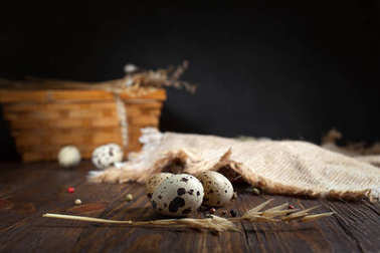 quail eggs on a napkin on a wooden table