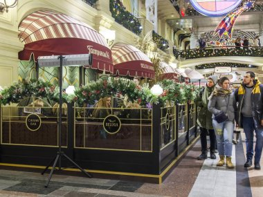 MOSCOW, RUSSIA, on December 17, 2016. The caviar Beluga bar in the trade gallery of historical shop GUM decorated by New Year's holidays