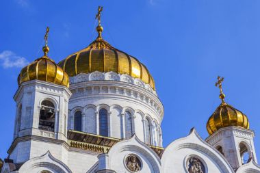 MOSCOW, RUSSIA, on August 10, 2017. The bright sun lights architectural details of a facade of the Cathedral of Christ the Saviour