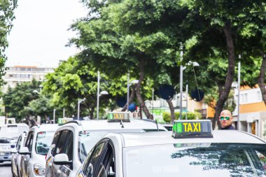 Las-Palmas de Gran Canaria, Spain, on January 11, 2018. Cars of the taxi go on the city street