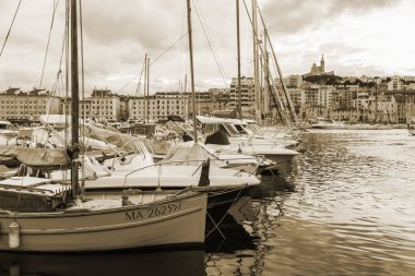 MARSEILLE, FRANCE, on March 2, 2018. The sunset sun lights numerous yachts and boats are moored in old city port which is one of city sights