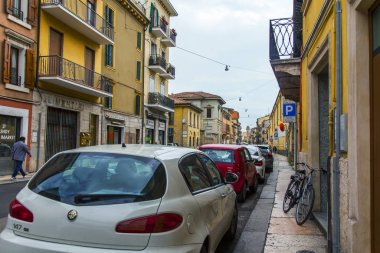 Verona, Italy, on April 24, 2019. Narrow picturesque street in the old town. Typical city skyline